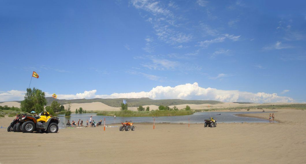 4-wheelers at Sand Dunes near the water.