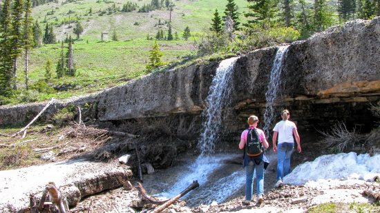 Climb behind a waterfall downstream from the cave. - Caves around rexburg