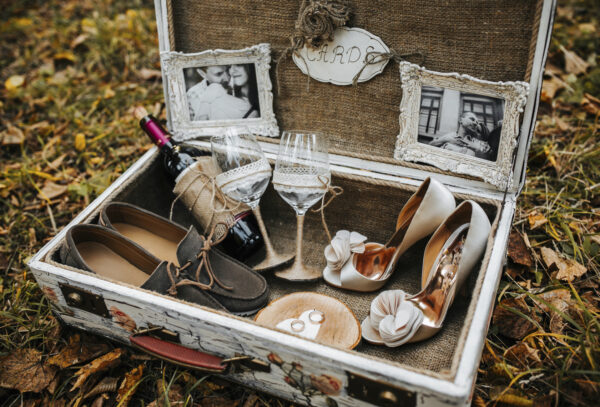 Vintage big suitcase with different wedding accessories